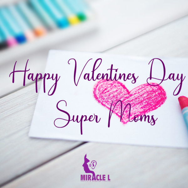 child with autism draw a heart to wish her mother happy valentines day