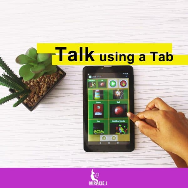 Child being taught by a speech therapist to use a tab (AAC) to communicate also know as Augmentative & Alternative Communication