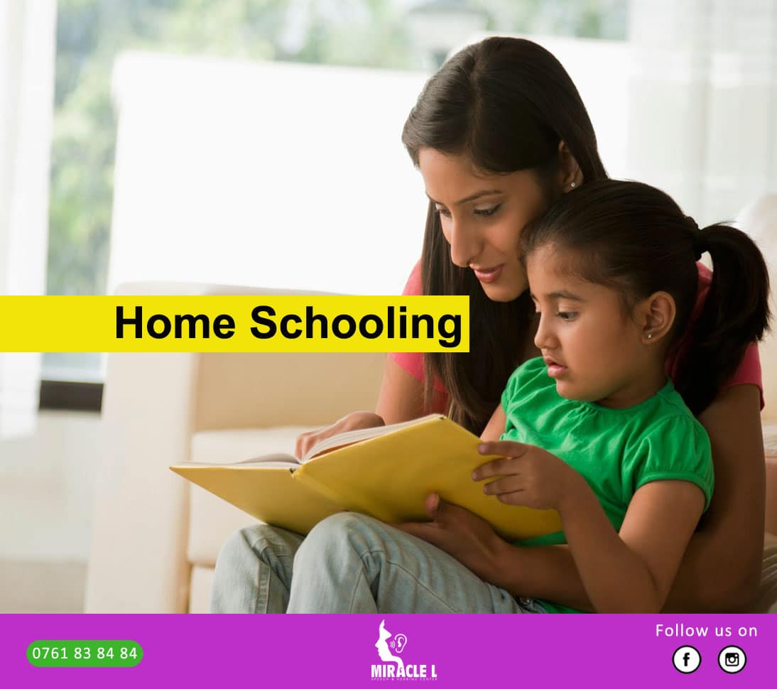 mother home schooling her daughter who is speech delayed